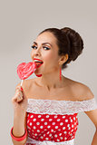 Happy Woman Lick Red Lollipop. Pin-up retro style.