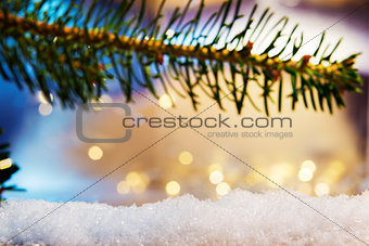 branch and artificial snow with bokeh lights