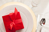 Christmas Gift with Place Setting at Table