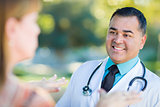 Hispanic Male Doctor or Nurse Talking With a Patient