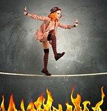 Clown balance on fire