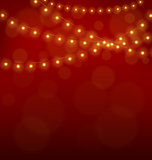 Golden Christmas lights on red