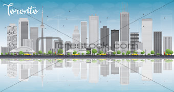 Toronto skyline with grey buildings, blue sky and reflection.