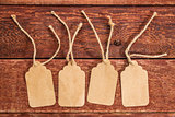 blank paper price tags on rustic wood