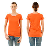 Serious woman with blank orange shirt