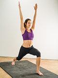 Woman doing warrior yoga position
