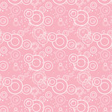 Seamless texture of pink circles and flowers.