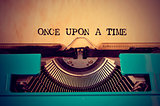 retro typewriter and text once upon a time