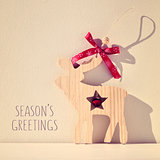 reindeer and text seasons greetings, filtered