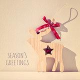 reindeer and text seasons greetings, filtered