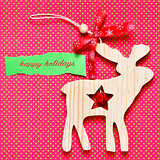 text happy holidays and rustic wooden reindeer