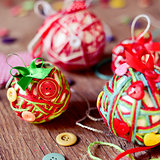 handmade christmas balls, made with, cords, ribbons and buttons