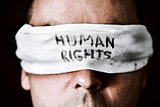 young man with a blindfold with the text human rights