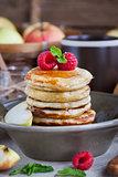 Breakfast with apple pancakes with honey