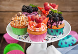 Set of different delicious cupcakes