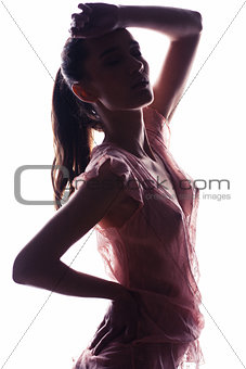 A silhouette of a woman in transparent blouse