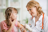 doctor vaccinating frightened preschool child