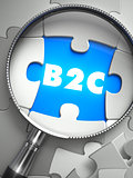 B2C - Puzzle with Missing Piece through Loupe.