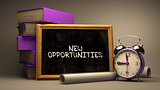 New Opportunities Handwritten on Chalkboard.