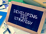 Developing SEO Strategy Handwritten on Chalkboard.