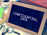 Confidential Data - Chalkboard with Hand Drawn Text.