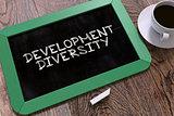 Hand Drawn Development Diversity on Chalkboard.