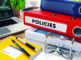 Policies on Red Ring Binder. Blurred, Toned Image.