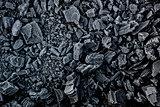 Black coal in white frost.