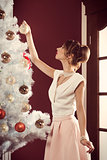 lovely female decorating christmas tree