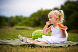 portrait of a little girl eating watermelon