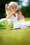 portrait of a little girl eating watermelon