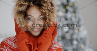 Cute young African woman in winter fashion