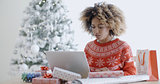 Young woman using a laptop at Christmas
