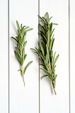 Rosemary on wooden background