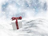 3D Christmas gift nestled in snow