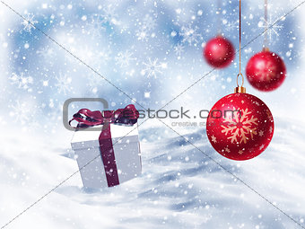 3D Christmas gift nestled in snow with hanging baubles