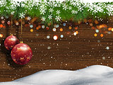 Christmas background with snow and hanging baubles