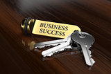 Room key with golden keychain business success concept