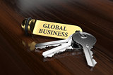 Room key with golden keychain global business concept