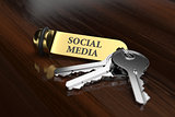 Room key with golden keychain social media concept