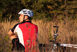 Mountain Bike cyclist resting outdoor with his bike