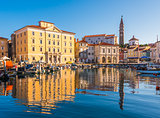 Buildings of Piran Old Town Reflected in Water.