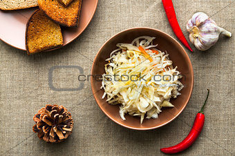 Top view of pickled cabbage on linen fabric background