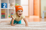 crawling kid or child at home on carpet