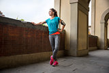 Young fitness woman is getting ready for outdoors jogging