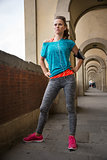 Portrait of young fitness woman standing close to Ponte Vecchio
