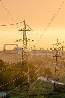 Power lines illuminated by the setting sun
