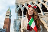Woman tourist with Italian flag on Christmas in Venice, Italy
