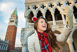 Happy woman tourist taking Christmas selfie in Venice, Italy