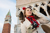 Happy woman tourist with camera on Christmas in Venice, Italy
